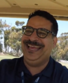 Erik Griffin in 2018, driving a golf cart.png