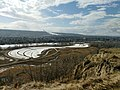 Escarpment view of Dale Hodges Park, a section of Bowmont Park Calgary with Calgary Olympic Park.jpg