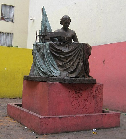 Bronze statue of a seamstress at corner of Manuel J Othon and San Antonio Abad at site of collapsed factory Estatuacosturera.jpg