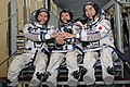 Expedition 42 backup crew members in front of the Soyuz TMA spacecraft mock-up in Star City, Russia.jpg