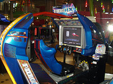 A blue sit-down arcade cabinet stylized in the shape of one of the game's hovercrafts.