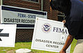 FEMA - 35384 - Setting Out Signs at Mobile DRC Site.jpg