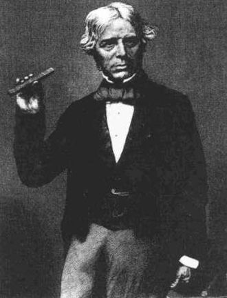Faraday effect - Faraday holding a piece of glass of the type he used to demonstrate the effect of magnetism on polarization of light, c. 1857.