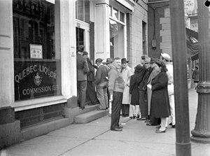 Société des alcools du Québec - A line of customers waiting to enter the store in the Commission des liqueurs de Québec located Saint Denis Street in Montreal. September 23, 1944.