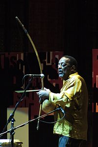 File-Naná Vasconcelos playing berimbau.jpg