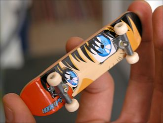 Fingerboard (skateboard) - Underside of a Tech Deck fingerboard including Japanese-style graphics. There are also more professional fingerboards made of wood.
