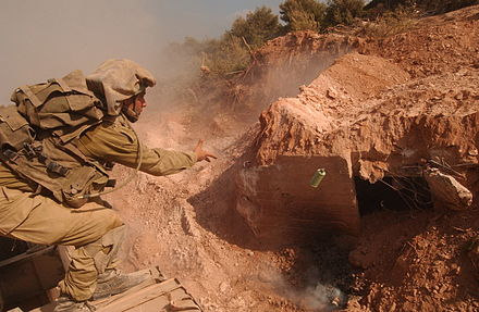 An Israeli soldier tosses a grenade into a Hezbollah bunker Flickr - Israel Defense Forces - Hezbollah Secret Bunker (1).jpg