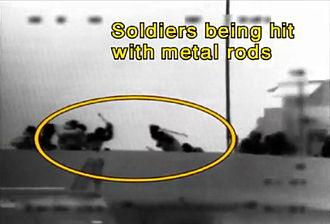 Gaza flotilla raid - Mavi Marmara passengers hit IDF soldiers with metal rods.