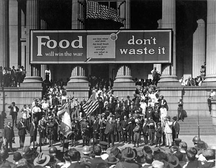 "Liberty Loan drive in front of City Hall, New Orleans. On City Hall is a banner reading ""Food will win the war--don't waste it"". FoodWillWinTheGreatWarNOLA.jpg"