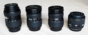 Lenses for SLR and DSLR cameras - A collection of lenses a DSLR owner might have. These are three Olympus zooms (40–150 mm, 11–22 mm and 14–54 mm) and a Sigma prime (30 mm), all for the Four Thirds System.