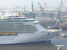 Cruise ship Freedom of the Seas, with drydock Elbe 17 on the background