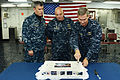 From left, U.S. Navy Capt. George J. Vassilakis, the commanding officer of the amphibious assault ship USS Bataan (LHD 5), and Capt. Neil A. Karnes, the commodore of Amphibious Squadron 6, stand by as Rear Adm 131111-N-HQ940-021.jpg