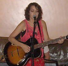 Gaby Moreno in a concert playing the guitar
