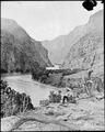 Gate of Lodore, Green River, N.W. Colorado? *James C. Pilling sitting peacefully on the bank smoking - NARA - 517756.tif