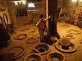 Georgian traditional kvevri jugs buried in a winery in Kakheti.jpg