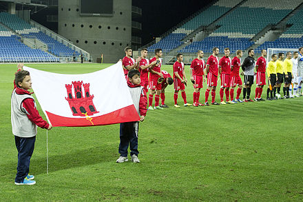 The Gibraltar national football team lining up in their first official match, against Slovakia, in 2013 Gibraltar starting XI.jpg