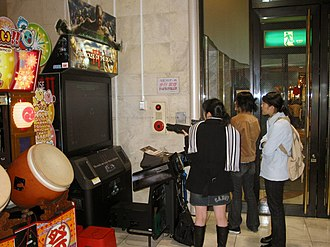 Arcade game - Girls playing The House of the Dead III in an amusement arcade in Japan, 2005.