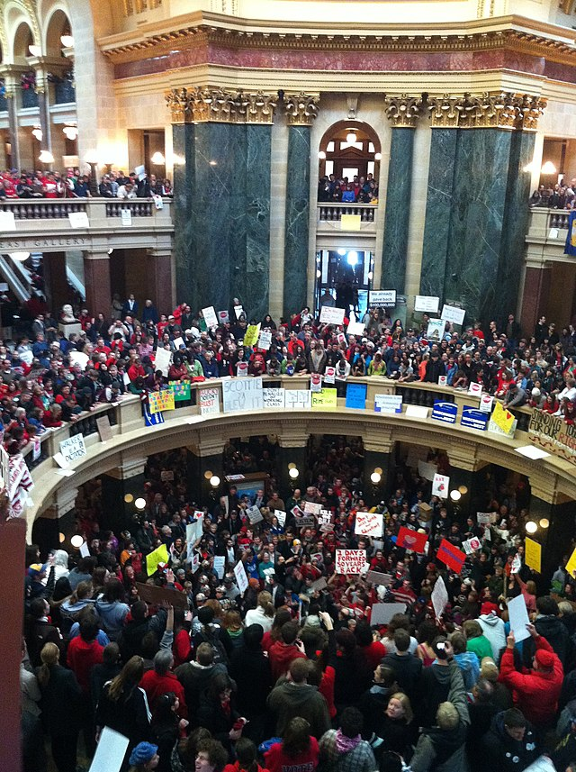 Overhead view of hundreds of people wearing red for the teachers' unions, protesting against Walker's bill.