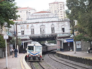 Göztepe railway station - A westbound train enters under the historical station building.