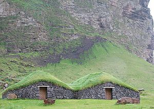 Houses with turf roofs on the island of Heimae...