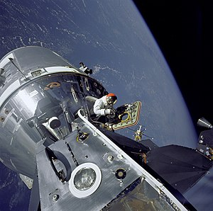 Apollo 9 - David Scott performs a standup EVA from Command Module Gumdrop, seen from docked Lunar Module Spider