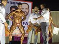 Harshit Pandey on stage for a bodybuilding competition.jpg