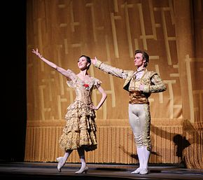 A photograph of Seo and Jared Matthews with their arms extended during the curtain call for Don Quixote on 17 May 2014