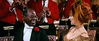 Hello, Dolly! (song) - Louis Armstrong as the orchestra leader with Barbra Streisand, singing the song in the 1969 film.