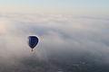 Hot air balloon rising above the clouds 1.JPG