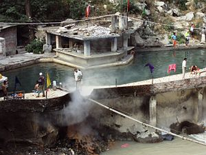 Mineral spring - Tourists and pilgrims having a bath in a hot spring in Gurudwara Complex, Manikaran in Uttrakhand state of India, c. May 2009.