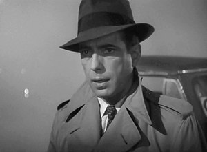 This screenshot shows Humphrey Bogart in a tre...