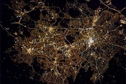 Birmingham and the wider West Midlands Built-up Area seen from the International Space Station at night from the south west ISS Birmingham at night.jpg