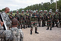Indian Army Maj. Arvind Singh demonstrates how to shoulder an M4 carbine to his men at Fort Bragg.jpg