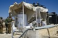 Indian and Greek soldiers with water purification plant, Somalia 1993.jpg