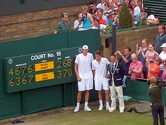 Isner–Mahut match at the 2010 Wimbledon Championships - Players pose by the scoreboard after the match