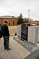 "J.R. Martinez, the winner of the 13th season of ABC's ""Dancing with the Stars"" and a former U.S. Soldier with the 2nd Brigade Combat Team, 101st Airborne Division, visits a memorial at Fort Campbell, Ky., Dec 111204-A-PY395-001.jpg"