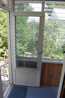 Glass jalousie window and storm door common on mid-20th-century homes in warm climates. : jalousie door - pezcame.com