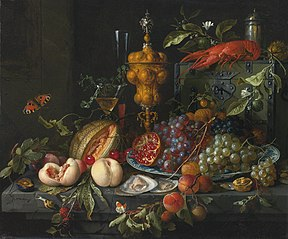 A still life upon a hard‐stone table in front of a stone wall