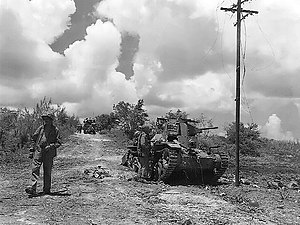 Battle of Tinian - Marines check out a Japanese tank knocked out of action.