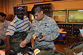 Jerry Lewis, left, helps Staff Sgt. Paul Cortinas select gas mask filters during mobility processing at Randolph Air Force Base, Texas, Sept 090923-F-LR258-277.jpg
