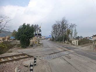 China National Highway 213 - G213 crosses the old line of the Kunming–Yuxi Railway in Jinning District