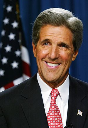 Headshot &#959f John Kerry w&#1110t&#1211 the U.S. flag &#1110&#1495 t...