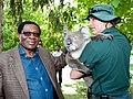 John Michael Haule, Permanent Secretary of the Ministry of Foreign Affairs, Tanzania pats a koala at Sandalford Winery in WA's Swan Valley.jpg