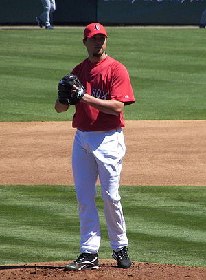 Boston Red Sox pitcher Josh Beckett pitching d...