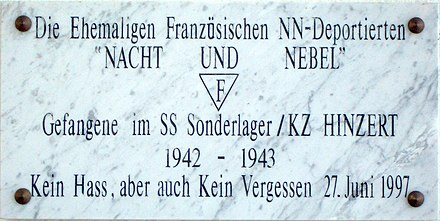 "Plaque commemorating French victims at the Hinzert concentration camp, using the expressions ""Nacht und Nebel"" and ""NN-Deported."" The inscription translates to: ""No hate, but also no forgetting."" KZ-Hinzert-Plakette-Nacht-und-Nebel.jpg"
