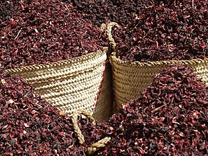 "Herbal tea - Baskets of dried hibiscus for making karkade, or ""hibiscus tea"", a popular herbal tea worldwide"