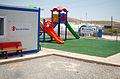 Kinderspielplatz im UNHCR Camp (15947084582).jpg