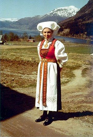 Bunad - Woman's bunad from Hardangerfjord. The headpiece, called a skaut, is worn by married women from Hardanger. Other headpieces are worn by Hardanger women, including beaded caps worn by young girls, and headband-like wraps worn by young unmarried women.
