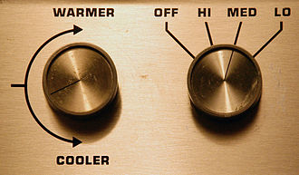 Control knob - Two control knobs for a heating/cooling system. The left knob controls the temperature while the right controls the fan speed.
