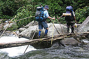 Crossing Eora Creek on the Kokoda Track